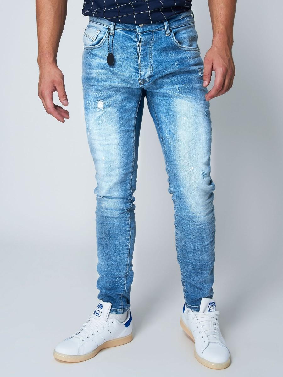 a8853541f Jean slim délavé effet usé bleu clair