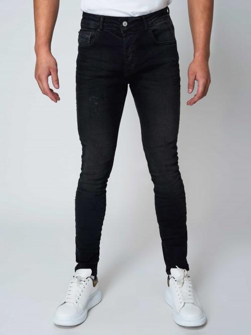 bf2e333752ddd Jean slim noir détails usés Homme Project X Paris