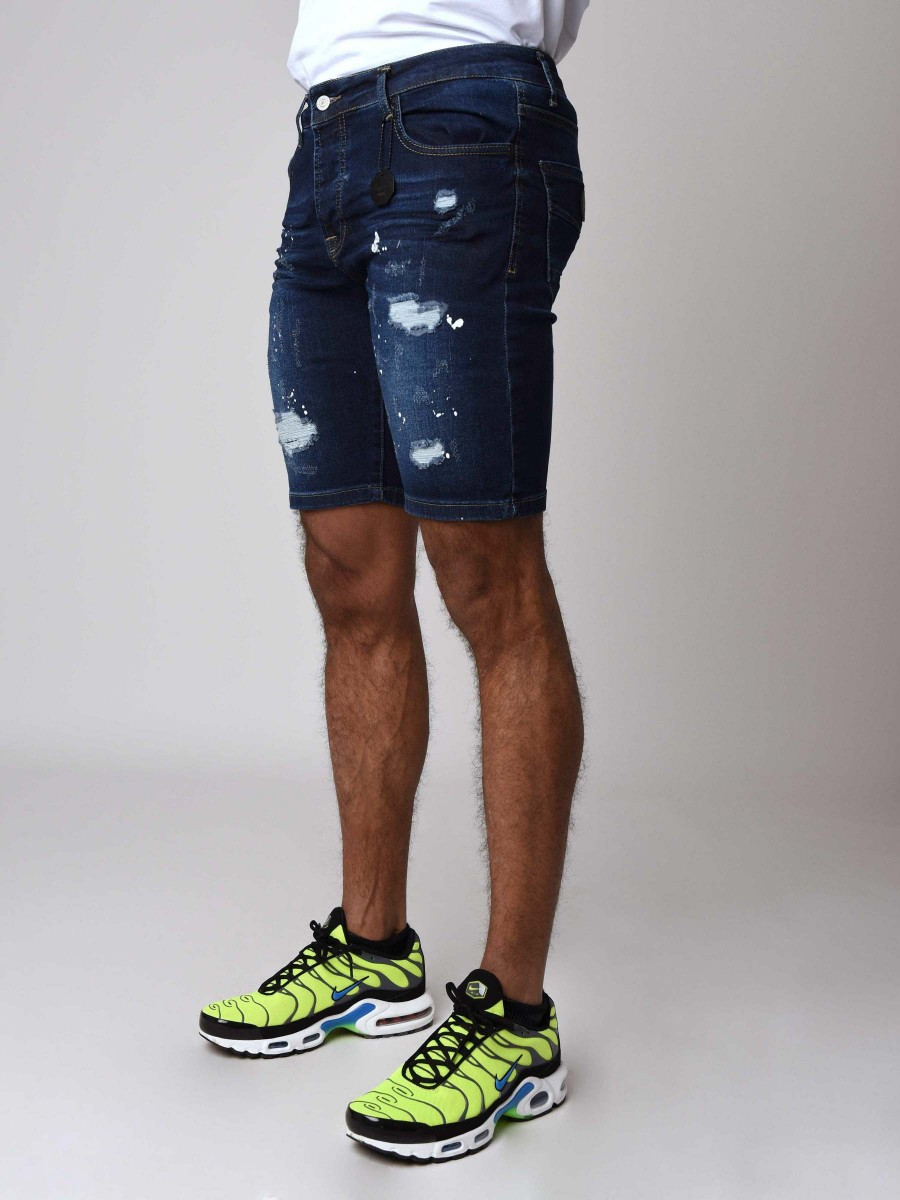 f5e727690f12 Skinny Denim Shorts With Rips and Paint Splatter in Navy Blue Project X  Paris