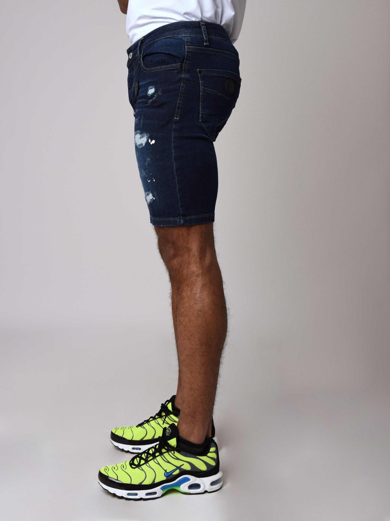 004bbb06c5e1 Men's Skinny Denim Shorts with Rips and Paint Splatter in Navy Blue ...