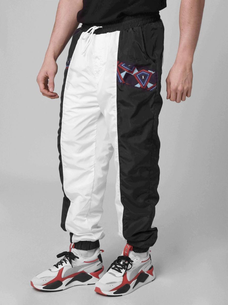 d57ab7203a8cb Pantalon de jogging empiècement motif Wax