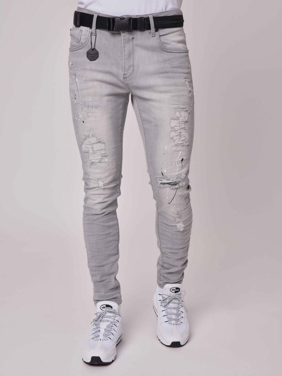 Skinny Fit Washed Jeans with Heavy Rips and Paint Splatter